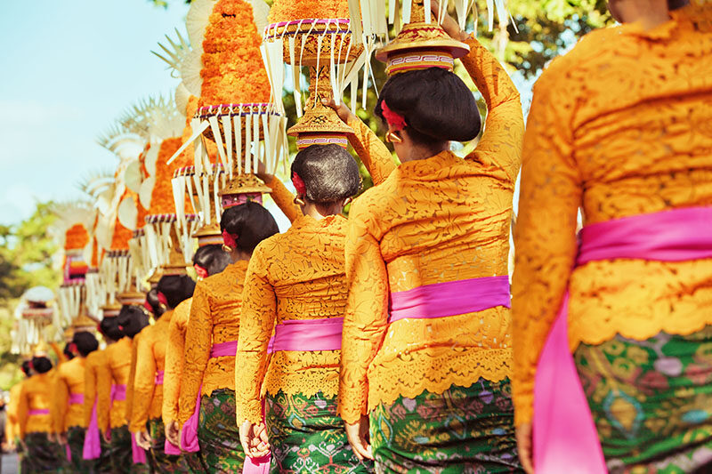 Procession of beautiful Balinese women in traditional costumes